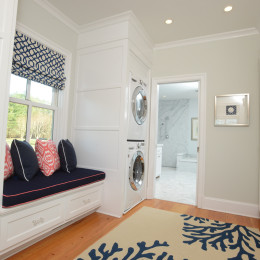 coastal haven design | coastalhavendesign.com | laundry room with navy and coral window seat