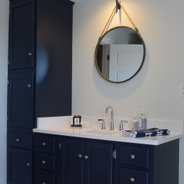 coastal haven design | coastalhavendesign.com | navy bathroom with nautical mirror