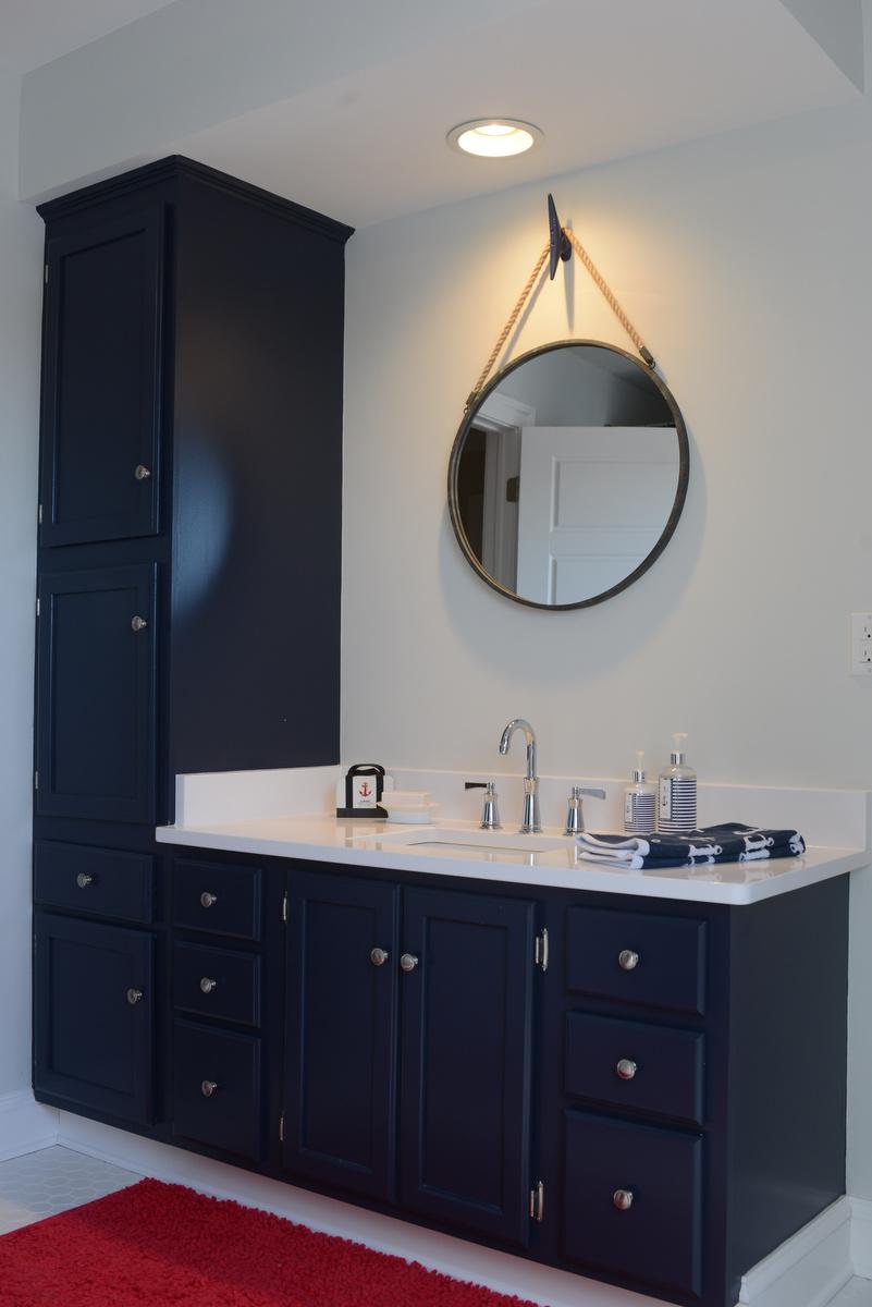coastal haven design   coastalhavendesign.com   navy bathroom with nautical mirror