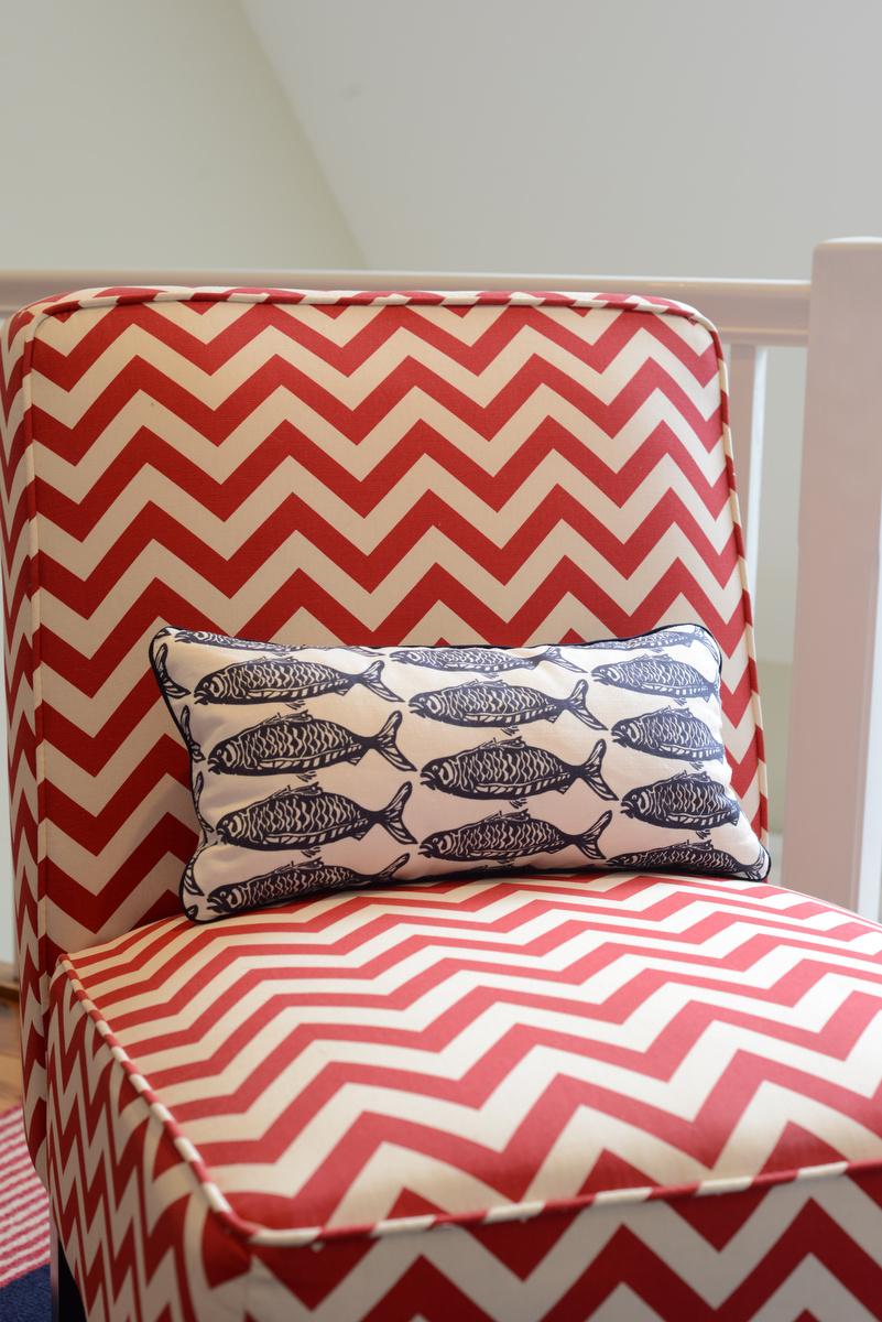 coastal haven design   coastalhavendesign.com   red chevron chair and navy fish pillow