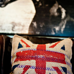 coastal haven design | coastalhavendesign.com | room styling details: horse painting and flag pillow