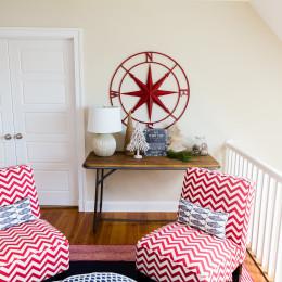 coastal haven design | coastalhavendesign.com | red and white chevron chairs with hokiday decor