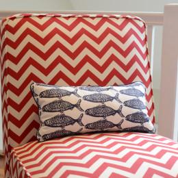 coastal haven design | coastalhavendesign.com | red chevron chair and navy fish pillow