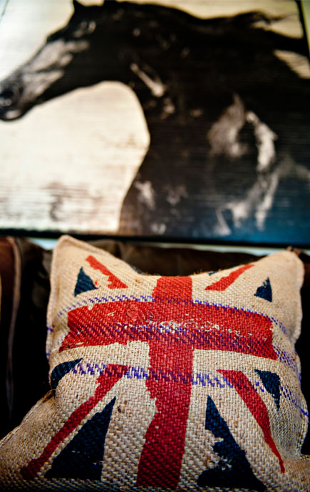 coastal haven design   coastalhavendesign.com   room styling details: horse painting and flag pillow