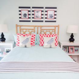 coastal haven design | coastalhavendesign.com | blue and coral bedding and pillows