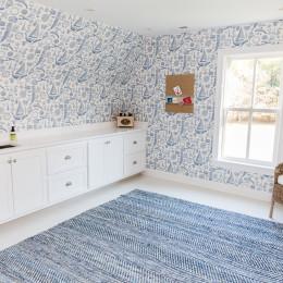coastal haven design | coastalhavendesign.com | white laundry room with wrap around wallpaper