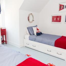coastal haven design | coastalhavendesign.com | boy's blue and red trundle beds
