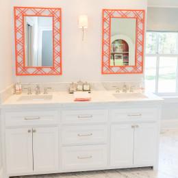 coastal haven design | coastalhavendesign.com | white vanity with pop of color mirrors