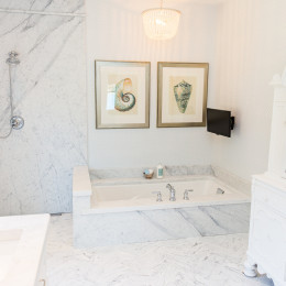 coastal haven design | coastalhavendesign.com | white marble bathtub in bathroom